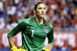 FILE - In this Oct. 20, 2013, file photo, United States goalkeeper Hope Solo pauses on the field during the second half of an international friendly women's soccer match against Australia in San Antonio. U.S. Soccer is standing by its decision to allow goalkeeper Hope Solo to continue to play while she faces domestic violence charges, Tuesday, Sept. 23, 2014.  (AP Photo/Darren Abate, File)
